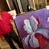 """Harry Lewis, 77, talks about some of his work from his exhibit """"painted thoughts"""" Wednesday, June 29, 2005 in the vault at Longview Museum of Fine Arts in Longview. (Kevin Green/News-Journal Photo)"""