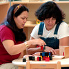 J. L. Everhart teachers Lizete Castro, left, and Margarita Womack, right, work with the blocks during a break in  magnet training Wednesday, June 29, 2005 at J.L. Everhart in Longview.  (Kevin Green/News-Journal Photo)