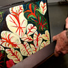"""Harry Lewis, 77, looks through some of his work from his exhibit """"painted thoughts"""" Wednesday, June 29, 2005 at Longview Museum of Fine Arts in Longview. (Kevin Green/News-Journal Photo)"""