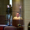 Sheriff's Deputies are reflected in a window as they guard the courtroom where a witness testifies in a capital murder trial Tueday, March 29, 2005 at the Gregg County Courthouse. (Les Hassell/News-Journal Photo)