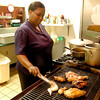 Lydia Rowell owner of Lydia's Caribbean cuisine Food prepares jerk chicken at her restaurant Thursday March 31, 2005. (Ricardo B. Brazziell/News Journal Photo)