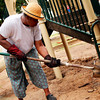 Lola Pullum of Jefferson helps spread dirt around the concrete and plastic pillars that are holding up the playground at new park on Sunday,May 29, 2005 at the New Jefferson City Park in Jefferson. (Courtney Case/News-Journal Photo)