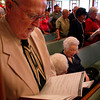 Kent Rose of Longview (left) sings a hymn with his wife Norma Rose (right, siting down with glasses) during the 10:45 am Service on Saturday, May 29, 2005 at Winterfield United Methodist Church in Longview. (Courtney Case/News Journal Photo)
