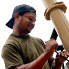 Samuel Williams of Jefferson tightens down a bolt while buidling a playground in the new Jefferson CIty Park on Sunday,May 29, 2005 at the New Jefferson City Park in Jefferson. (Courtney Case/News-Journal Photo)