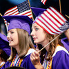 From left  Rebecca Sustaire with classmate Taylor Whyte both from Hallsville, wave small American Flags during a tribute to our armed forces overseas on Friday, May 27, 2005 during the Hallsville High School Graduation at Bobcat Stadium in Hallsville.(Courtney Case/News-Journal Photo)
