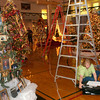 Oakland Heights Family Life Center director Millie Edwards unpacks itmes for the Festival of Trees display Monday, November 28, 2005 at the center in Longview.   (Kevin Green/News-Journal Photo)