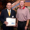 Craig Parr, left, with Smith Barney,  with a Caring award and 100% award, United Way campaign chairman Jack Lenhart, right, at the report breakfast Friday, September 30, 2005 in Longview. (Kevin Green/News-Journal Photo)