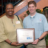 Bonita Hall, City of Longview, holds their First Care award, Chuck Ewings, right, United Way  public service division chairman, right, at the report breakfast Friday, September 30, 2005 in Longview. (Kevin Green/News-Journal Photo)
