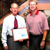 Mike Northcutt, Southside Bank, with a Caring award, United Way campaign chairman Jack Lenhart, right, at the report breakfast Friday, September 30, 2005 in Longview. (Kevin Green/News-Journal Photo)