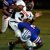 Daingerfield's Corey Nixon (7) puts a hit on Gilmer Buckeye Curtis Brown during the game Friday, September 30, 2005 in Daingerfield. (Matt Boggs/ News-Journal Photo)