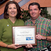 Shannon Trest, left, with the Womens Center of East Texas, with a Care Share award and 100% award, United Way's Shayne Cowan, right, at the report breakfast Friday, September 30, 2005 in Longview. (Kevin Green/News-Journal Photo)