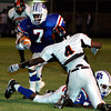 Daingerfield's Corey Nixon carries the ball versus the Gilmer Buckeyes during the game on Friday, September 30, 2005 in Daingerfield. (Matt Boggs/ News-Journal Photo)