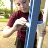 Brittany Cardwell, 14, paints iron columns on a house volunteers renovated and repaired on Scenic Drive in Longview, Saturday, April 1, 2006, as part of the annual Citywide Cleanup sponsored by Keep Longview Beautiful. Volunteers from several organizations including the Highway 80 Rescue Mission, the Greggton University United Methodist Church Youth Ministry and LeTourneau University students participated in the renovation.