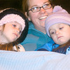 Elizabeth McLean watches the Christmas parade in downtown Longview with daughters from left, Kara, 5, and Courtney, 4, on Friday, December 1, 2006.  (Luisa Morenilla/News-Journal Photo)