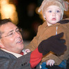 Mayor Jay Dean holds his two year old grandson Reed Cooper, as he rides through the Christmas parade in downtown Longview on Friday, December 1, 2006. (Luisa Morenilla/News-Journal Photo)
