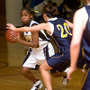 Mount Pleasant's Aleah Robinson attempts to pass the ball while Pine Tree's Katelyn Stark tries to block her, during the Jo Ann Sparks Shootout Championship game at Spring Hill High School Saturday, December 2, 2006. (Luisa Morenilla/Longview News-Journal)