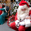 Santa Claus talks to 4 month old Alec Germanwala, as Mrs. Claus visits with his sister Arya, 3, at the Breakfast with Santa event at the Longview Museum of Fine Arts on Saturday, December 2, 2006. (Luisa Morenilla/Longview News-Journal)