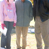 """From left to right, LeTourneau University student Marcita Bowie, and University staff members Linda Higgs and Carlton Mitchell, pray for the people with AIDS whose pictures are displayed in the mall area around the University bell tower, on Friday, December 1, 2006. Bowie said she encouraged Higgs and Mitcell to pray at the display with her because """"anyone can help by praying, because God always answers prayers."""" (Luisa Morenilla/Longview News-Journal)"""