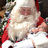 Santa Claus talks to 4 month old Alec Germanwala at the Breakfast with Santa event at the Longview Museum of Fine Arts on Saturday, December 2, 2006.   (Luisa Morenilla/Longview News-Journal)