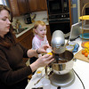 Melinda Dunn, left, prepares Brownie Bars while her 22 month old daughter Rebecca Dunn looks on Tuesday, February 28, 2006 at her home in Longview.  (Kevin Green/News-Journal Photo)