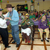 Green Street Recration Center Green Hatter Etta Mizell, left, dances with resident Duane Morrell,  Tuesday, February 28, 2006 during the Mardi Gras parade at Highland Pines Nursing and Rehabilitation Center in Longview. (Kevin Green/News-Journal Photo)