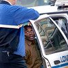 Longview Police Department detective Rob Bowen, left, questions Darryl Mollet, right, after he was taken into custody from a stolen car Tuesday, February 28, 2006 at the intersection of Green Street and East Methvin Street in Longview.  (Kevin Green/News-Journal Photo)