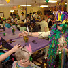 Highland Pines Nursing and Rehabilitation Center's Candace Read, right, passes out Mrdi Gras beads during the 7th annual Mardi Gras parade Tuesday, February 28, 2006 at the center in Longview.