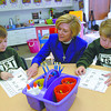 Trinity School of Texas headmaster The Rev. Charlene Miller visits with students Dylan Pace, 4, left, and Robbie Lewis,4, right at the school Tuesday, January 31, 2006 in Longview.  (Kevin Green/News-Journal Photo)