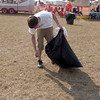 "Daylan Gray, 15, picks up trash at the Great Texas Balloon Race kids area, as part of the ""Don't Mess With Texas"" program, Saturday, July 15, 2006.(Luisa Morenilla/Longview News-Journal)"
