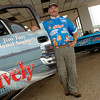 Professional angler Jim Tutt poses next to his GMC truck Monday, March 27, 2006 at Lively Olds Cadillac in Longview. (Kevin Green/News-Journal Photo)