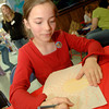 Kandice Driscoll, 11, of Daingerfield, draws during the drawing contest Friday, March 24, 2006 at Wet Pets & Critters in Longview.  (Kevin Green/News-Journal Photo)
