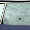 Two of many bullet holes in the side of a car parked at a house in the 500 block of Idylwood Drive after a late night shooting Thursday, March 23, 2006 in Longview. (Kevin Green/News-Journal Photo)