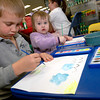Wade Seidel,6, left, and Riley Seidel, 18 months, right, both of Longview,  draw during the drawing contest Friday, March 24, 2006 at Wet Pets & Critters in Longview.  (Kevin Green/News-Journal Photo)