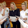 Hallsville High School Bobcat Belles director Freda Goerner, center visits with team members after they performed the national championship winning routine Friday, March 24, 2006 at the gym in Hallsville.  (Kevin Green/News-Journal Photo)