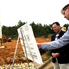 Pat Martin, the project engineer of the new production facility and sales office being built on FRJ Drive in South Longview by Hanson Pipe and Products, explains the building plans to Mayor Jay Dean at the groundbreaking ceremony Tuesday, May 2, 2006.