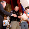 DARE officer Wayne Burgess, center, hands out certficates, and Gregg County Judge Bill Stoudt, left, shakes hands with graduates of the DARE program at the Sabine Elementary School DARE graduation ceremony, in the school's auditorium in Liberty City, Tuesday, May 2, 2006. All of the school's fifth grade classes particpated in the DARE program during the school year and recieved certificates marking their successful completion of the program.(Luisa Morenilla/Longview News-Journal)