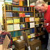 Jim Carey shows customer Durward Smith a pair of baseball shorts in his store on Marshall Avenue, Wednesday, May 3, 2006. The facility doubles as a store open to the public, and as a storage warehouse for items he sells on Ebay. (Luisa Morenilla/Longview News-Journal)
