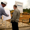 Pat Martin, the project engineer of the new production facility and sales office being built on FRJ Drive in South Longview by Hanson Pipe and Products, displays and explains the plans for the buildings at the groundbreaking ceremony Tuesday, May 2, 2006.  (Luisa Morenilla/Longview News-Journal)