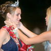 Jessica Warren, a junior at White Oak High School is crowned homecoming queen by 2004 homecoming queen Jennifer Guthrie, at White Oak Stadium Friday night, October 6, 2006. (Luisa Morenilla/Longview News-Journal)