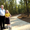 Councilman John A. Sims, poses with Mykayla Fontaine, 8, on the new Paul G. Boorman Trail Wednesday, October 4, 2006.  The concrete pathway beginning at the corner of Bill Owens Parkway and Fairmont Street and winding south to West Marshall Avenue, currently under construction, is the result of Fontaine's request to Mayor Jay Dean for a safe place where she can ride her bike and scooter.  (Luisa Morenilla/Longview News-Journal)