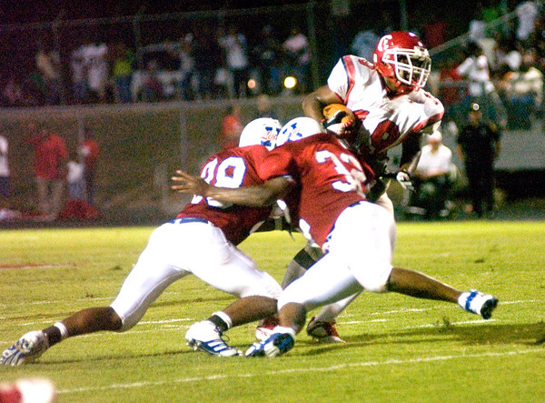 Coleman Hales of the Carthage Bulldogs is tackled during the game against the Henderson Bulldogs at Lion Stadium in Henderson Friday night, September 1, 2006. (Luisa Morenilla/Longview News-Journal)