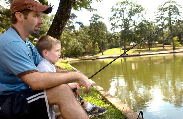Zack Witt fishes with his son Keaton, 4, at Teague Park in Longview, Wednesday September 6, 2006. Witt says he and his son were out enjoying the cooler temperatures.  (Luisa Morenilla/Longview News-Journal)
