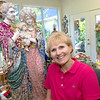 Jeanie Folzengoen poses in her workroom with the statue she has been working on for the past few months, which will be auctioned at Wunderfall, a dinner, dance and silent auction event on September 23, which benefits St. Mary's Catholic School in Longview. (Luisa Morenilla/Longview News-Journal)