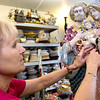 Jeanie Folzengoen finishes mosaicking a statue which will be auctioned off at Wunderfall, a dinner, dance and silent auction event on September 23, which will benefit St. Mary's Catholic School in Longview.(Luisa Morenilla/Longview News-Journal)