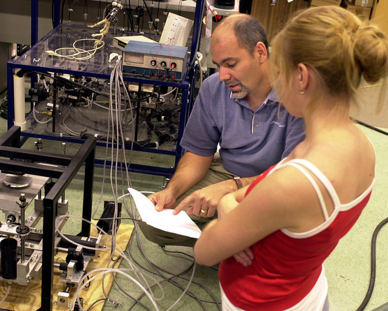 Dr. Roger Gonzalez, left, and student Jessica Niemi discuss a project in the biomedical engineering research department at LeTourneau University on Tuesday, September 26, 2006. The National Institutes of Health has awarded the department $206,849 for their work. (Les Hassell/News-Journal Photo)