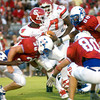 Marcus Bowman of the Carthage Bulldogs is tackled during the game against the Henderson Bulldogs at Lion Stadium in Henderson Friday night, September 1, 2006.  (Luisa Morenilla/Longview News-Journal)