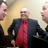 New department chaplain Ben Andrus, center, laughs with Chaplain Jim Renfro, left, and Richard Spruiell, coordinator for the chaplain corps, following the ceremony to install him as department chaplain at the Roy Stone Police Training Center on Tuesday, September 5, 2006. (Luisa Morenilla/Longview News-Journal)