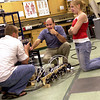 Dr. Roger Gonzalez, center, discusses a project with students Josh Bowen and Jessica Niemi in the biomedical engineering research department at LeTourneau University on Tuesday, September 26, 2006. The National Institutes of Health has awarded the department $206,849 for their work. (Les Hassell/News-Journal Photo)