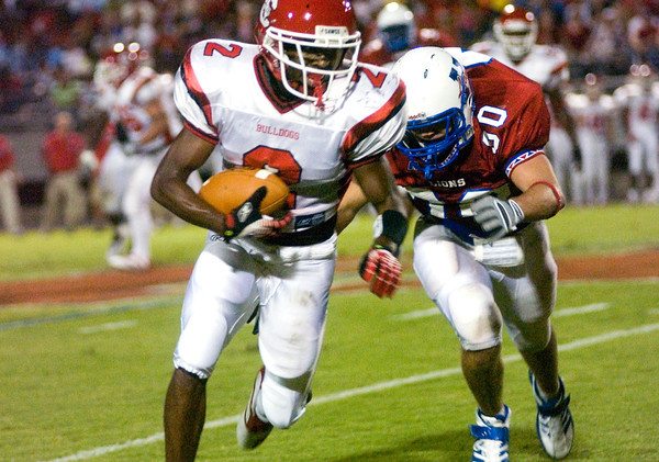 Kendrick Jackson of the Carthage Bulldogs is tackled during the game against the Henderson Bulldogs at Lion Stadium in Henderson Friday night, September 1, 2006. (Luisa Morenilla/Longview News-Journal)