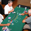 From left, Darian Rachal of Alexandria, David Mangrum of Longview and Charlie Stevenson of Longview play a game of black jack Saturday night at the Longview Museum of Fine Arts Annual Casino night.  Jacob Croft Botter